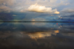 Dreamy cloud with reflection. Dreamy light cloud with reflection in steady water Royalty Free Stock Image