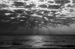 Dreamy clouds over the sea. A breathtaking view with the Black Sea and a sky full of dark clouds that makes the sun light slips nicely between them royalty free stock photography
