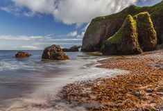 Dreamy Coast. Cushendun arch in the Glens of Antrim, Northern Ireland, UnitedKingdom royalty free stock photo