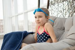 Dreamy cute swimmer resting om lounge chair stock photo