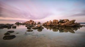 Dreamy Daybreak II. A long exposure of the sunrise above Palombaggia beach, Tamaricciu beach on Corsica, France Royalty Free Stock Photos