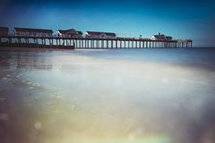 Long exposure of Southwold pier and sea on Suffolk coast Royalty Free Stock Photo