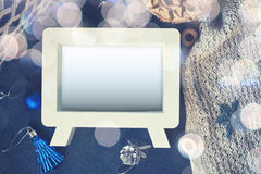 Dreamy effect photo frame with blue Christmas toys and cloth on Royalty Free Stock Photo