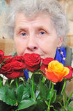Dreamy elderly woman. With bouquet rose Stock Photography