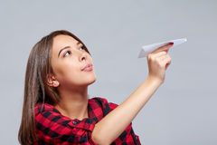 Dreamy female holding white paper plane Royalty Free Stock Images