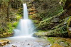 Dreamy, forest waterfall in it`s amphitheater stock photography
