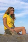 Dreamy girl. Attractive girl representing brasil, sitting on a rock Stock Images