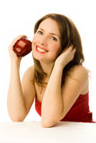 Dreamy girl with an apple Stock Images
