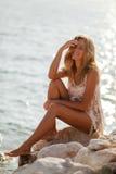 Dreamy girl on beach Stock Photos