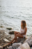 Dreamy girl on beach with sea view Stock Photo