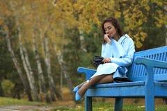 Dreamy Girl on a Bench Royalty Free Stock Photos