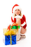 Dreamy girl with Christmas presents Royalty Free Stock Images