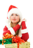 Dreamy girl with Christmas presents. Dreamy lovely girl dressed as Santa with Christmas presents Royalty Free Stock Photos
