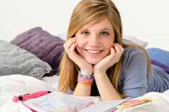 Dreamy girl dreaming about love over diary Stock Images