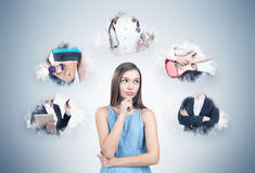Dreamy girl in a dress and a career choice Stock Images