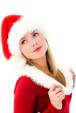 Dreamy girl dressed as Santa Stock Photos