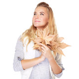 Dreamy girl with dry leaves Stock Photo
