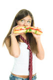 Dreamy girl eating a sandwitch Royalty Free Stock Photos