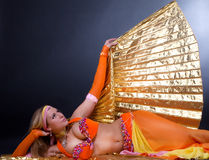 Dreamy girl on floor Stock Image