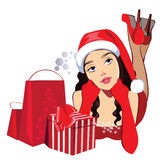 Dreamy girl with gifts in christmas hat Stock Photos