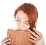 Dreamy girl holding a book Stock Image
