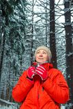 Dreamy girl with hot mug of tea. In winter forest Stock Photography