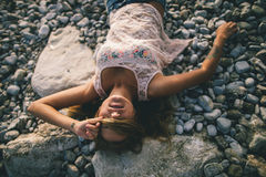Dreamy girl laying on beach Royalty Free Stock Photos
