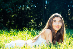 Dreamy girl lying in tha grass Stock Photo