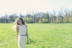 Dreamy girl in a meadow Royalty Free Stock Image