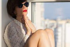 Dreamy girl near the window Royalty Free Stock Photos