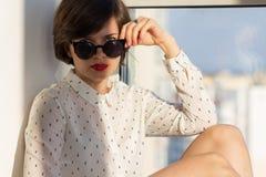 Dreamy girl near the window Stock Photography