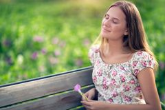 Dreamy girl in the park stock photography
