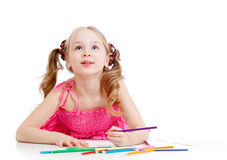 Dreamy girl with pencils on white Royalty Free Stock Image
