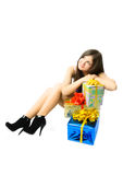 Dreamy girl with presents Royalty Free Stock Images