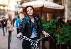 Dreamy Girl Rides Bicycle On Street Tourist Town Royalty Free Stock Photography