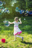 Dreamy Girl Soap Bubbles Stock Image