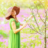 Dreamy girl in spring garden Stock Photography