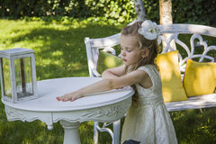 Dreamy girl. Girl standing near table with decorative box for wishes. Lost memories concept stock photo