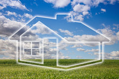 Dreamy House Icon Over Grass Field and Sky Stock Photo