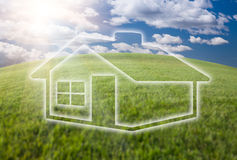 Dreamy House Icon Over Grass Field and Sky Royalty Free Stock Image