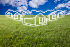 Dreamy Houses Icon Over Grass Field and Sky Stock Photography