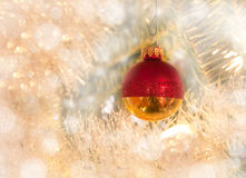 Dreamy image of a Christmas bauble in red and gold Stock Photos