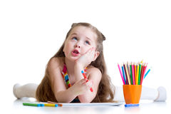 Dreamy kid girl with pencils Royalty Free Stock Photo
