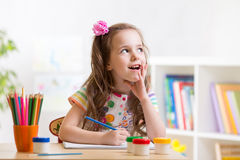 Dreamy kid girl with pencils Stock Photos