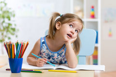 Dreamy kid girl with pencils Royalty Free Stock Image