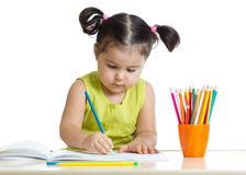 Dreamy kid girl with pencils Stock Photo