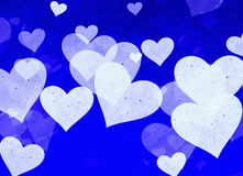 Dreamy light hearts on blue background Royalty Free Stock Images