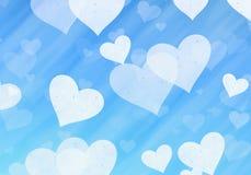Dreamy light hearts on blue backgrounds. Love symbol Stock Photography