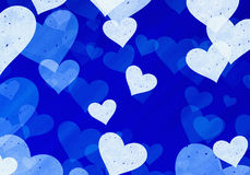 Dreamy light hearts on blue backgrounds. Love symbol Royalty Free Stock Image