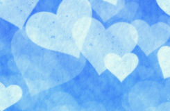 Dreamy light snow hearts on blue background Royalty Free Stock Image